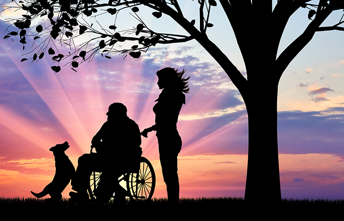 Concept of caring for a disabled person and house of aged
